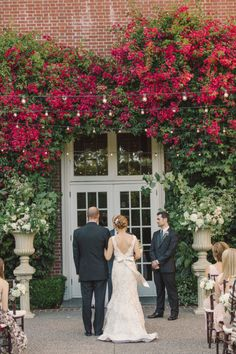 Wall of flowers = perfect ceremony backdrop. Photography: Carlie Statsky Photography - carliestatsky.com Read More: http://www.stylemepretty.com/2014/06/10/outdoor-elegance-at-the-kohl-mansion/