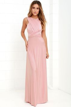 "Any which way you wrap it, the Always Stunning Convertible Blush Pink Maxi Dress is one amazing dress! Two, 83"" long lengths of fabric sprout from an elastic waistband and wrap into dozens of possible bodice styles including halter, one-shoulder, cross-front, strapless, and more. Stretchy blush fabric has a satiny sheen, and a full length maxi skirt pairs perfectly with any choice you make up top. Want Styling Tips? <a href='http://bit.ly/HowToWearIt' target='_blank'>See How To Wear It!</a>"