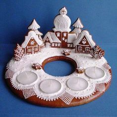 Gingerbread village with advent candles Gingerbread Village, Christmas Gingerbread House, Noel Christmas, Christmas Goodies, Gingerbread Man, Christmas Baking, Gingerbread Cookies, Christmas Crafts, Christmas Decorations
