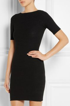 Black stretch-knit  Slips on 48% viscose, 36% wool, 9% polyamide, 6% polyester, 1% elastane Dry clean