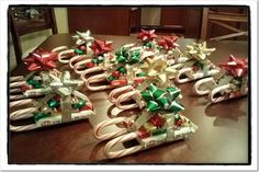 Candy Sleighs- Great idea for a big family gathering. Just put two candy canes down and build up from there. Slip a gift card in between it somewhere and you have a awesome gift for your family and friends!