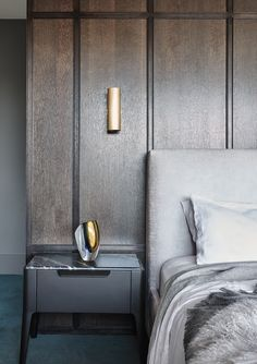 A dark panneled bedroom designed by Sally Caroline. Photo by Dan Hocking.