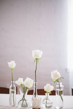 Mismatched vases with single white blooms...sweet and simple! Photography: Taylor Made Art - taylormadeart.com/index2.php  Read More: http://www.stylemepretty.com/2014/06/25/all-white-modern-hollywood-wedding/