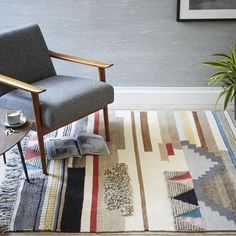 Inspired by 1970s wall hangings, our Fair Trade Certified™ Boho Textured Wool Rug mixes multicolored wool, jute and cotton in varied textures. Each beautifully detailed rug is handcrafted by Craftmark-certified artisans in India. By purchasing this pouf, you're supporting better living and working conditions—artisans earn a premium for each piece sold, empowering them to collectively invest in their surrounding communities.
