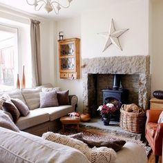 Looking for country living room decorating ideas? Take a look at this neutral living room with a feature wall from Country Homes & Interiors for inspiration. For more living room ideas, such living room feature wall ideas, visit our living room galleries Cottage Living Rooms, Home Living Room, Living Room Designs, Cottage House, Barn Living, Cozy Living, House Rooms, Apartment Living, Country Style Living Room