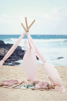 The sweetest beach tent ever.  Shot by Simply Bloom Photography on Style Me Pretty.