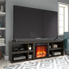 Finish your living room or man cave with the classic Ameriwood Home Glenco Fireplace TV Stand. This simple TV Stand can accommodate most TVs up to 70 in. W or up to 120 lbs. The black oak woodgrain finish Tv Over Fireplace, Fireplace Inserts, Tv Stand With Fireplace, 70 Inch Tv Stand, Simple Tv Stand, Electric Fireplace Tv Stand, Tv Decor, Home Decor, Decor Ideas