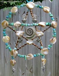 Pentacle Windchime, to represent the element of Earth. Made with a Starfish in the centre.