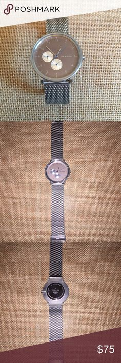 Skagen 'Hald' Series Watch Sleek, minimalist design.  Silver tone stainless steel mesh strap with taupe face.  Deep blue second hand adds unique detail.  Model # SKW6205.  Listed at retail as a men's watch but fits a woman's wrist nicely too.  Excellent condition!  Never worn.  Sold as is - no box. Skagen Jewelry