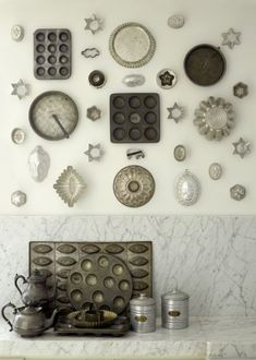 a constellation of vintage baking tins ... kitchen wall art ... gray ... silver ...white