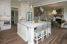 The kitchen in the New England Homes Farmhouse Parade home