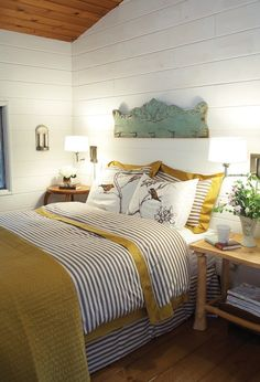 Charming mustard yellow & grey striped bedding. Walls with horizontal wainscotting. Love the birds too.