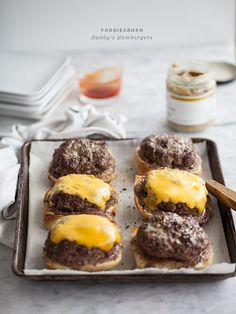 Daddy's Hamburgers are baked, not grilled, and have a secret ingredient for maximum juicy flavor: Butter! #recipe #hamburgers