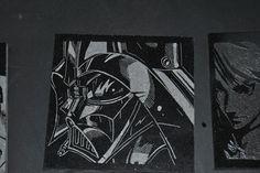 Darth Vader engraved on black granite tile.