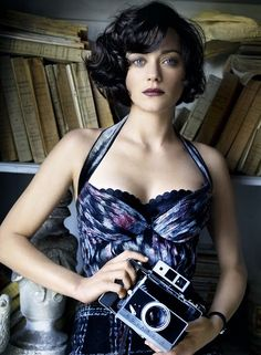 Marion Cotillard. I don't think you could do better for a vintage photo shoot...hair, dress, camera and all.
