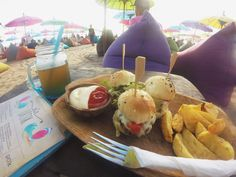 https://meandplaces.wordpress.com/2016/08/05/la-plancha-iconic-bali-beach-bar/#more-878  La Plancha- Iconic Bali Beach Bar If you're looking for a chill place with a hippy and easy approach while buried in a beanbag, and a sure-hit palatable meals, Be here.