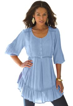 The classic tunic is updated with beautiful touches of brilliant embroidery and romantic ruffles. #Pantone #PlacidBlue