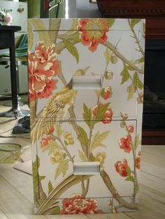 How to Cover a File Cabinet - using spray paint, wallpaper paste and wallpaper, a boring metal cabinet was given a whole new look.