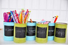 these tin cans are painted then have chalkboard paint on them... cheap and cute for classroom supplies