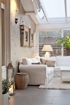 White sofa with cream walls and accessories.