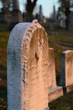 lichens and marble tombstone - New Year's Day sunset - Greenwood Cemetery Brooklyn, NY - deux lunes