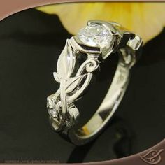 Green Lake Jewelry Style # 55716 #Engagement # Jewelryworks.. Decorative Vines and LEAVES overlapping the curls in the setting with a half Bezel Mounting... Wonderful Style of Art to show off!!!