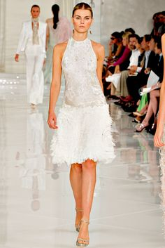 3/1/15 This Ralph Lauren dress from his Spring 2012 collection is inspired by the flapper dress of the 1920s. You can see how it is present in this dress by the tubular look, dropped waist, embellished top and feathered bottom.