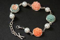 New to StumblingOnSainthood on Etsy: Peach and Blue Flower Bracelet with Personalized Charm. Blue and Peach Flower Bracelet. Silver Flower and Pearl Bracelet. Handmade Bracelet. (26.00 USD)