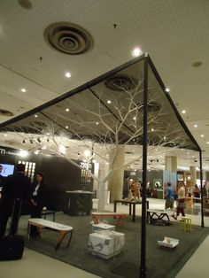 Trade Show booth idea that could be great for displaying garden art or suncatchers - ornaments, ect!: