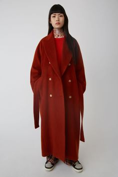 afd232d5b53 Acne Studios rust orange double breasted coat constructed of a luxurious