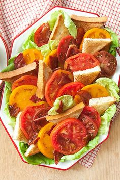 You can't go wrong with a classic BLT, only this time it's in salad form. Click through to get the recipe for this Heirloom Tomato BLT Salad and for more easy tomato salad recipes! #tomatosaladideas #tomatosaladrecipes #partyappetizers #easytomatosaladideas