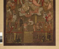 Painting showing Kṣitigarbha in the centre, seated on a rock under a canopy, holding a staff and a cintamani (flaming jewel). At the two sides are the Ten Kings of Hell, each one seated behind a desk like a magistrate, flanked by assistants. Before the Bodhisattva stands the monk Daoming with his lion, and an ox-headed jailor leading the soul of a man wearing a cangue, who is viewing his sins in a mirror. Blank cartouches stand on alternate sides of the Ten Kings. Two inscribed cartouches…