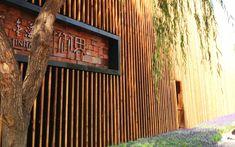 We are a global and creative design studio in Geneva, Tokyo and Beijing. Restaurant Facade, Tree Restaurant, Restaurant Design, Wall Exterior, Exterior Design, Asian Garden, Slat Wall, Wooden Slats, Garden Trees