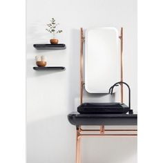 A stylish all in one vanity basin and mirror with copper surround, nice for powder room or small modern bathroom. #vanities #basins