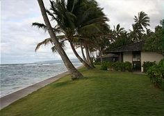 In the gated Mokuleia Beach Colony, there are 26 charming duplex cottages. Only five actually face the ocean. This is one of them. You'll wake to the sound of waves, sit on your open lanai and see n...