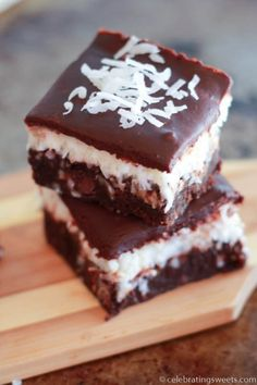 Fudgy brownies with a layer of creamy sweet coconut, topped with a smooth chocolate ganache. A delicious, rich and decadent dessert.