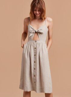 e64ceaf698 Loving this airy linen dress featuring a peekaboo cutout + a twirl-worthy  button-