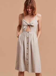Loving this airy linen dress featuring a peekaboo cutout + a twirl-worthy button-front skirt.
