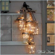 Just when you thought you'd seen every brilliant mason jar craft, here;s Moon Over Mason Jar Light. This spectacular craft combines many mason jars into one stunning chandelier and teaches you how to make a lantern. Diy Mason Jar Lights, Mason Jar Light Fixture, Mason Jar Lighting, Mason Jar Lamp, Light Fixtures, Jar Candle, Mason Jar Storage, Candle Holders, Mason Jar Projects