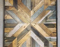 This listing is for ONE handcrafted piece. Bring the warmth and character of reclaimed barn-wood into your home. This unique art piece will the focal point of any wall. Reclaimed, unfinished barn wood give this piece depth and individuality. Crafted completely by hand, no two are exactly the same. Looks incredible as a group of three or four. > This listing is for ONE 20 x 20 piece > Individually handcrafted to order > No two are the same  > Mounting hardware included  >>Ple...