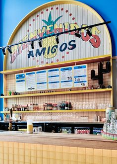 bold colors and mesh arches define the interior of techné's paco's tacos restaurant #negozio #mexico