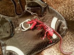 Red Leather T-Rex on a Guess bag~ Rarr! #bagcharm #leather #dinosaur #skeleton #TRex