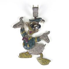 9 ct white gold Donald Duck pendant. 9 ct white gold Donald Duck pendant. Set with white, green and yellow diamonds with a ruby set bow tie and tongue. Length 76 mm. Weight 29 grams.