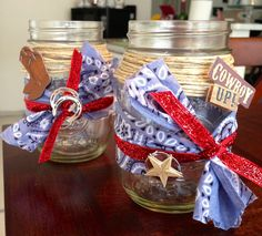 Cowboy/Western Centerpieces. Bandana scraps, twine, ribbon, & scrapbook embellishments! Easy, cute n' fun! Add some yellow daisies & your table scape is complete! ⭐