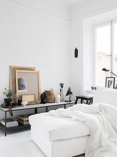 white bedding in light filled bedroom as seen on sfgirlbybay | A perfectly styled marble sideboard with art | White footstool | Get the look with an IKEA Kivik footstool with a Bemz cover in Absolute White Belgian Linen