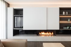 Maybe white will not fade from sun? I like the lighting. Home Design Living Room, Living Room Tv, Living Room With Fireplace, Living Room Furniture, Fireplace Tv Wall, Modern Fireplace, Fireplace Design, Wall Tv, Wood Wall
