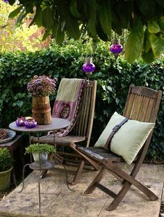 like the dark wood and lavender colors on this little bistro set patio