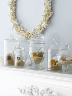 Mantle décor in apothecary jars
