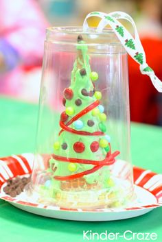 My Frosted Classroom Christmas Party - Maria Manore Gavin (Kinder-Craze) - My Frosted Classroom Christmas Party use a plastic cup as a perfect carrying container for frosted christmas trees… MUST remember to come back to this pin next Christmas! Frosted Christmas Tree, Cone Christmas Trees, Preschool Christmas, Christmas Crafts For Kids, Christmas Activities, Christmas Projects, Holiday Crafts, Christmas Holidays, Cone Trees