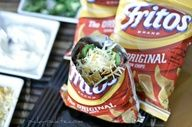Walking Tacos--- open small bags of Fritos, spoon in Chili, Lettuce, Salsa, Cheese, Sour Cream. Stick a fork in it to mix it up and eat!!! Good for camping or tail-gating.